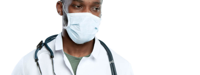 male-young-doctor-with-stethoscope-and-face-mask-isolated-on-white